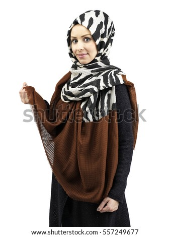 young muslim women portrait in islamic dress and scarf