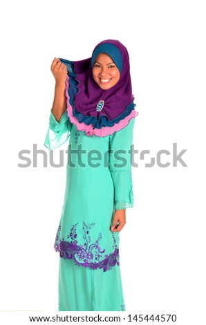 Young Muslimah in action on white background - stock photo