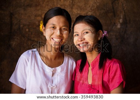 Young Myanmar girls with Thanaka, a yellowish-white paste made from ground bark and used as a cosmetic and for sunburn protection.