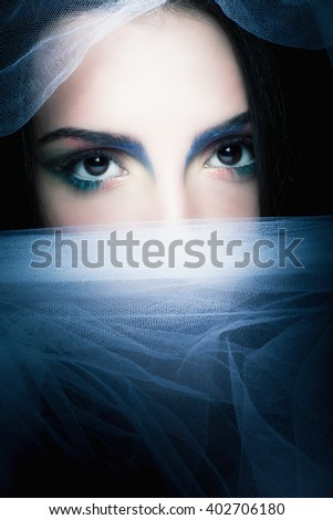 young mysterious woman portrait with white veil  - stock photo