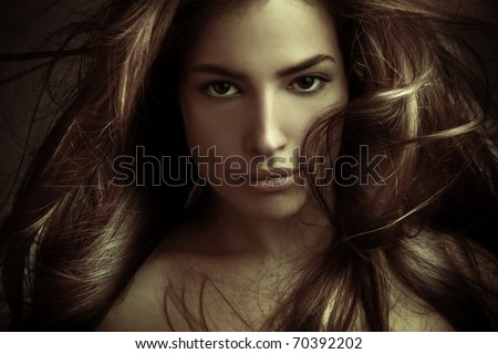 young mystical beautiful woman with long hair in motion, studio shot
