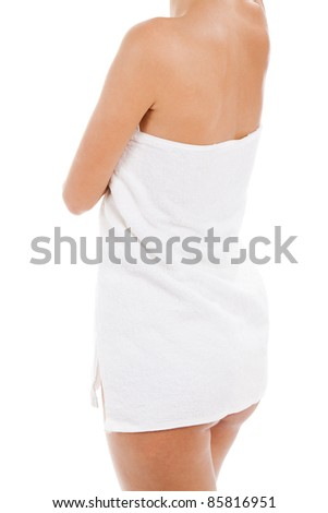 Young naked woman covering her self with towel on white background - stock photo