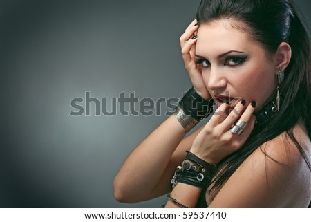 young naked woman in chain on black background - stock photo