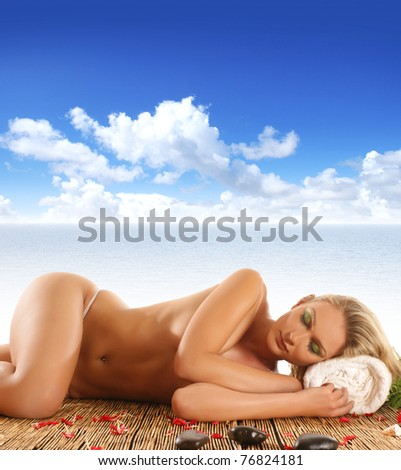 Young naked woman in spa isolated on white - stock photo