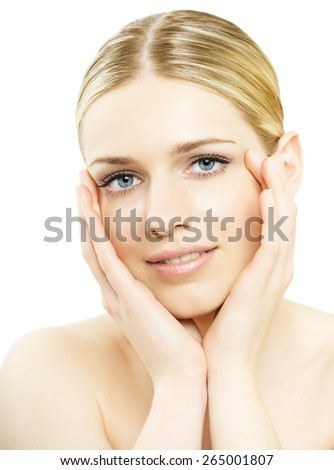 Young natural blond Caucasian woman in bright light over white background.
