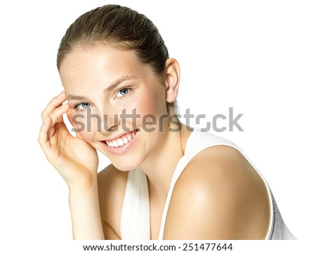Young natural North-European woman with freckles posing in studio. - stock photo