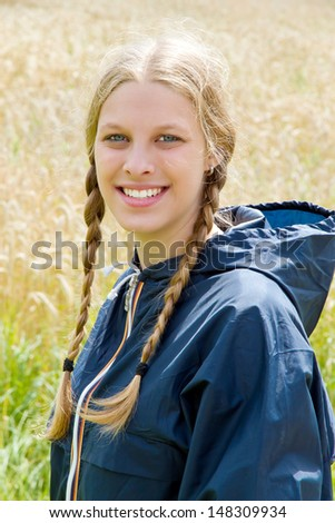 Young natural smiling girl in nature - stock photo