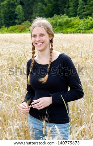 Young natural woman in a wheat field