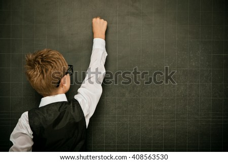 young nerd student with glasses and blackboard - stock photo