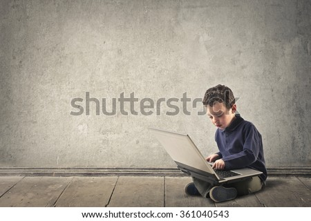 Young nerd using a pc