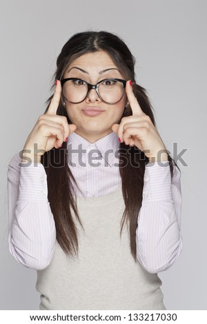 Young nerd woman crazy expression posing on white background - stock photo