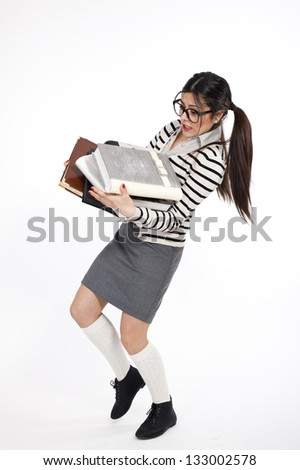 Young nerd woman holding a lot of books - stock photo