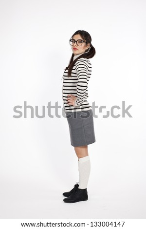 Young nerd woman standing on white background