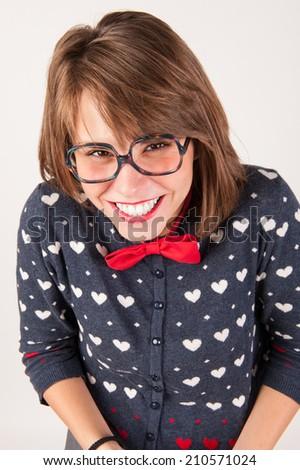 Young nerdy shy girl. Studio shot. - stock photo