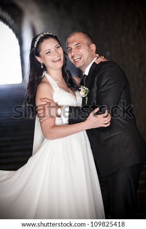 Young newly married couple hugging in tunnel - stock photo