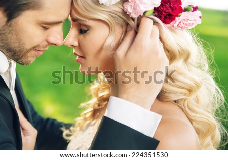 Young newly married couple posing  - stock photo