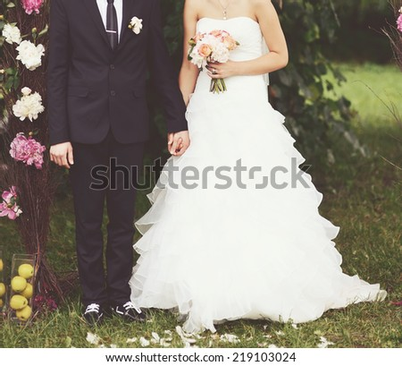 Young newly wed couple together on happy wedding day. - stock photo