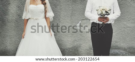 Young  newlywed caucasian couple together. Wedding day. - stock photo