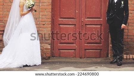 Young newlywed couple together on wedding day.  - stock photo