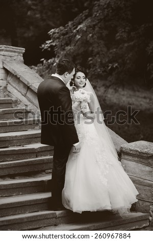Young newlywed couple together. Wedding picture in monochrome.  - stock photo