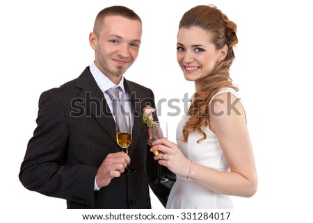 Young newlywed couple with champagne glasses