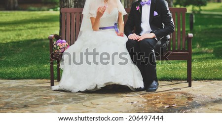 Young newlyweds spending happy wedding day together. - stock photo