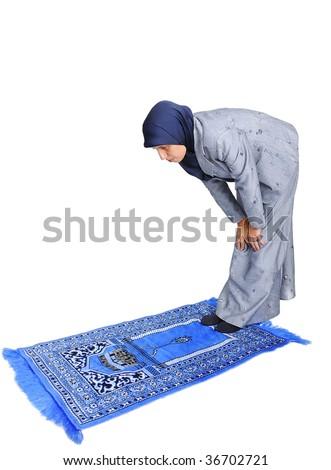 Young nice muslim female praying on traditional way - stock photo