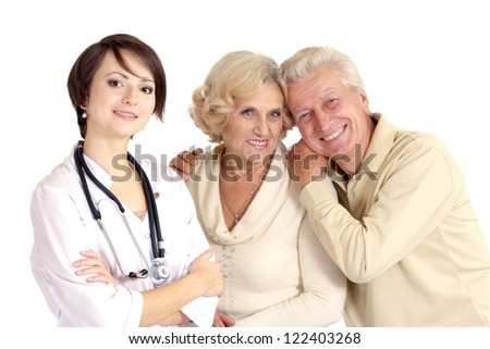 young nice nurse with elderly on a light background - stock photo