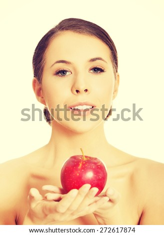 Young nude woman holding an apple