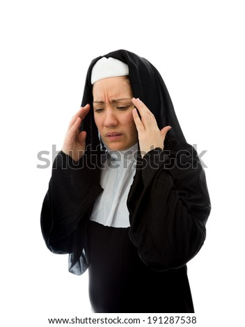 Young nun suffering from headache - stock photo