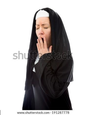 Young nun yawning - stock photo