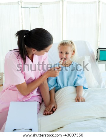 Young nurse attending a child patient in a hospital