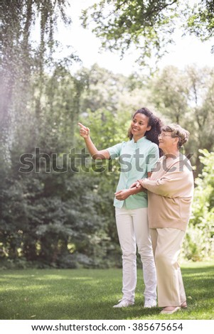 Young nurse is talking with elder woman - stock photo