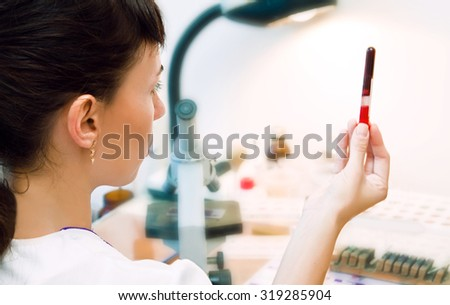 young nurse lab to conduct experiments in a lab - stock photo