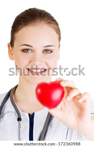 Young nurse with heart in her hand , isolated on white. - stock photo