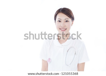 Young nurse with stethoscope, isolated on white background - stock photo