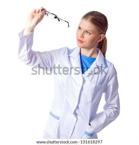 Young optician woman doctor looking through eyeglasses isolated on white background