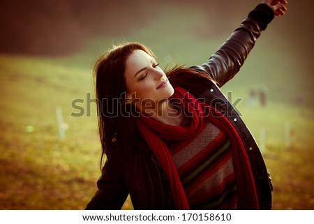 young ordinary woman enjoy in nature  autumn day, retro colors - stock photo