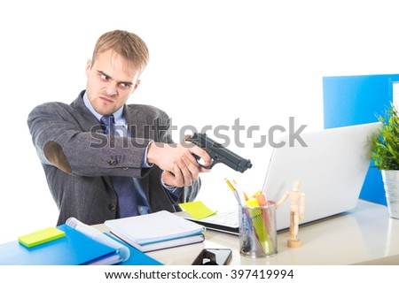young overworked and overwhelmed businessman in upset face expression holding gun pointing to computer suffering stress in business long hours working concept - stock photo