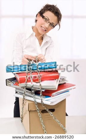 Young overworked secretary - stock photo