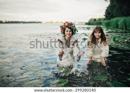 Young pagan Slavic girl conduct ceremony on Midsummer - stock photo