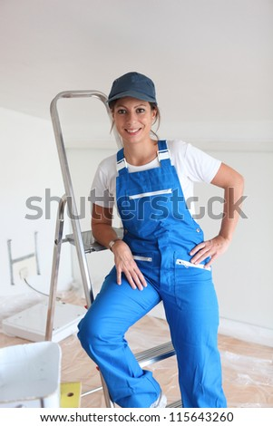 Young painter climbing ladder - stock photo