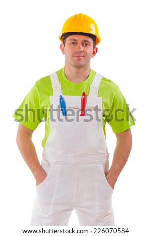 young painter with hands in pockets looking at camera isolated on white background - stock photo
