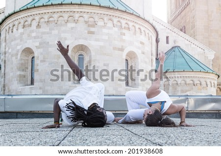 Young pair capoeira partnership ,spectacular sport - stock photo