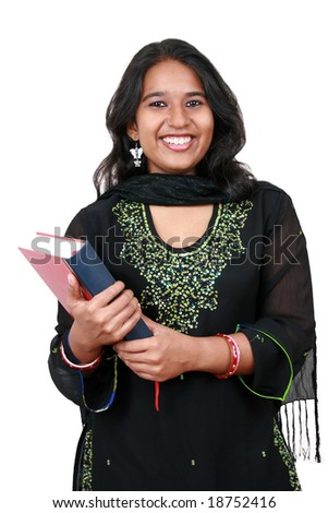 Young Pakistani student holding a book. Isolated on white. - stock photo