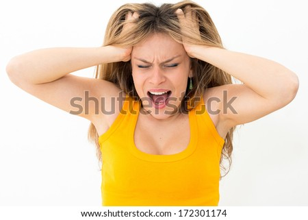Young panic woman with hands on the head