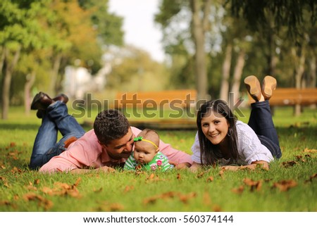 young parents with their baby girl in the park