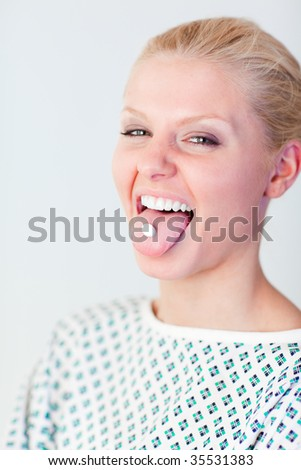Young Patient with a pill in her mouth - stock photo