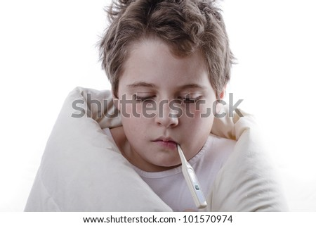 Young patient with fever, with digital thermometer and white blanket