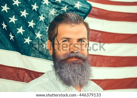 young patriotic happy bearded man with long blue beard on american flag background outdoor celebrating independence day usa